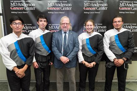 Lamar's Drumline Lead parade for Noble Prize winner : Dr. Jim Allison