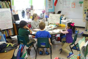 Ms. Kathryn McCracken working with students