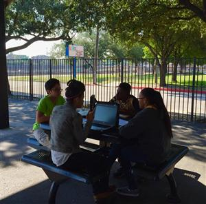 HAIS students take their learning outside with new laptops.