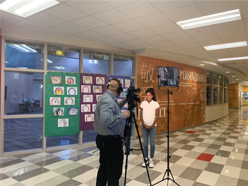 HISD TV filming a middle school student