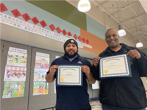 Mr. Lupe and Mr. Doucet with certificates