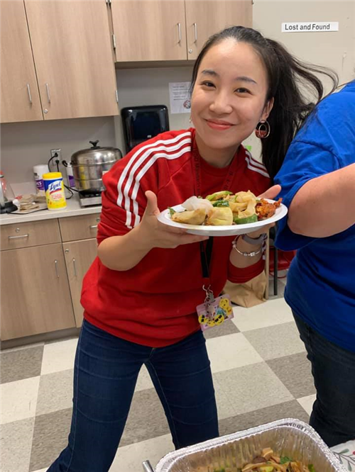 Ms. Zhang with a plate of good food!