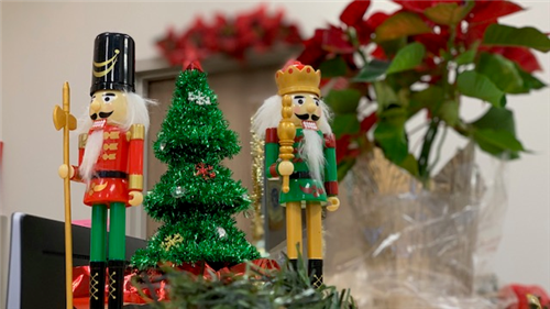Nutcrackers with a tinsel Christmas tree