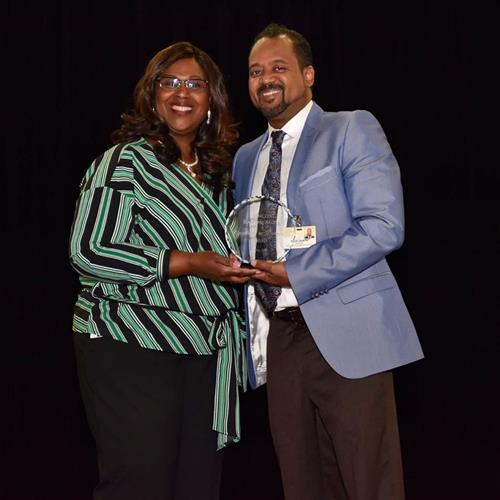 Principal Moss Receives the Excellence in Leadership Award
