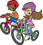 Two students riding bikes