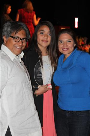 Angie Bonilla and her First Place plaque at the Asia Society Center, with Principal Ms. Moreno and teacher Mr. Severino.