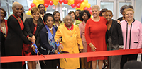 Yates High School welcomes guests to the Lion's Den to celebrate school's grand opening